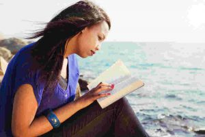 A young woman reading the bible.